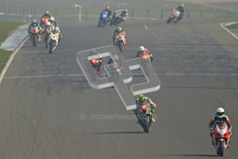 © Octane Photographic Ltd. Thundersport – Donington Park -  24th March 2012. Morello Services Thundersport GP1 / Superstock 1000, the pack heading over the start finish line. Digital ref : 0258cb7d2919