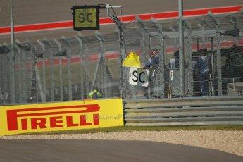 World © Octane Photographic Ltd. F1 USA GP, Austin, Texas, Circuit of the Americas (COTA), Sunday 17th November 2013 - Race. Waved yellow flag. Digital Ref : 0861lw1d2673