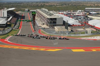 World © Octane Photographic Ltd. F1 USA GP, Austin, Texas, Circuit of the Americas (COTA), Sunday 17th November 2013 - Race. Sebastian Vettel in his Red Bull RB9 leads the pack into the 1st corner. Digital Ref : 0861lw1d5903