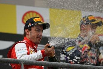 World © Octane Photographic Ltd. F1 Belgian GP - Spa-Francorchamps, Sunday 25th August 2013 - Podium. Scuderia Ferrari F138 - Fernando Alonso celebrates his 2nd place. Digital Ref : 0798lw1d0768