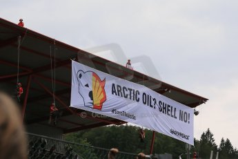 """World © Octane Photographic Ltd. F1 Belgian GP - Spa-Francorchamps, Sunday 25th August 2013 - Podium. Anti Shell Arctic drill activists Greenpeace """"Savethearctic.org"""" protesting on the main grandstand. Digital Ref : 0798lw1d1000"""