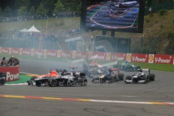 World © Octane Photographic Ltd. F1 Belgian GP - Spa-Francorchamps, Sunday 25th August 2013 - Race. The backmarkers headed by  Pastor Maldonado (Williams) safely clear turn 1 on the opening lap. Digital Ref : 0797lw1d0736
