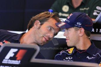 World © Octane Photographic Ltd. F1 Belgian GP - Spa - Francorchamps. Thursday 22nd August 2013. FIA Press Conference. Scuderia Toro Rosso STR8 - Jean-Eric Vergne talking with nfiniti Red Bull Racing driver Sebastian Vettel. Digital Ref : 0782lw1d6937