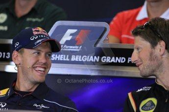 World © Octane Photographic Ltd. F1 Belgian GP - Spa - Francorchamps. Thursday 22nd August 2013. FIA Press Conference. nfiniti Red Bull Racing RB9 - Sebastian Vettel talking with Lotus F1 Team driver Romain Grosjean. Digital Ref : 0782lw1d6961