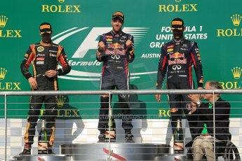 World © Octane Photographic Ltd. F1 USA GP, Austin, Texas, Circuit of the Americas (COTA), Sunday 17th November 2013 - Podium. Infiniti Red Bull Racing - Sebastian Vettel (1st), Lotus F1 Team - Romain Grosjean (2nd) and Infiniti Red Bull Racing - Mark Webber (3rd). Digital Ref : 0862lw1d6259