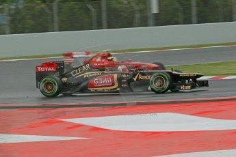 World © Octane Photographic Ltd. F1 Spanish GP, Circuit de Catalunya, Friday 10th May 2013. Practice 1. Romain Grosjean - Lotus and Felipe Massa - Scuderia Ferrari. Digital Ref : 0659cb1d9009