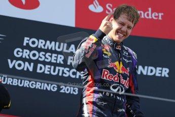 World © Octane Photographic Ltd. F1 German GP - Nurburgring. Sunday 7th July 2013 - Podium. Infiniti Red Bull Racing - Race Winner Sebastian Vettel. Digital Ref : 0750au8i0367
