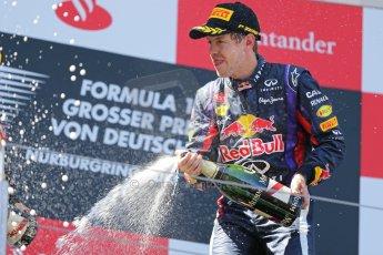 World © Octane Photographic Ltd. F1 German GP - Nurburgring. Sunday 7th July 2013 - Podium. Infiniti Red Bull Racing - Race Winner Sebastian Vettel celebrates. Digital Ref : 0750au8i0495