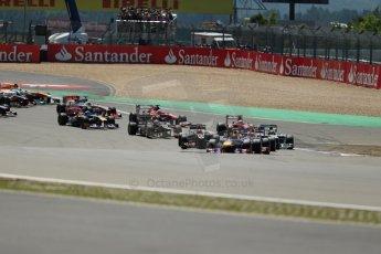 World © Octane Photographic Ltd. F1 German GP - Nurburgring. Sunday 7th July 2013 - Race. Infiniti Red Bull Racing RB9 - Sebastian Vettel and Mark Webber lead the pack from the start. Digital Ref : 0749lw1dx9331