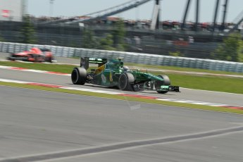 World © Octane Photographic Ltd. F1 German GP - Nurburgring. Sunday 7th July 2013 - Race. Caterham F1 Team CT03 - Giedo van der Garde and Marussia F1 Team MR02 - Jules Bianchi. Digital Ref : 0749lw1dx9706