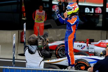 World © Octane Photographic Ltd./Chris Enion. GP2 British GP, Silverstone, Sunday 30th June 2013. Race 2 winner Jon Lancaster - Hilmer Motorsport celebrates in Parc Ferme. Digital Ref : 0732ce1d9513