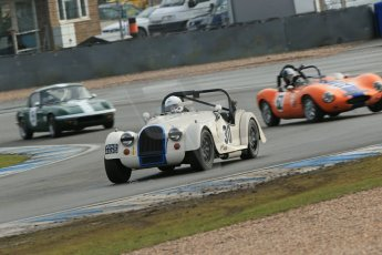 World © Octane Photographic Ltd. Donington Park 80th Anniversary Meeting (March 1933 – March 2013). HSCC Historic Road Sports Championship supported by Witchampton Garage (Inc. Class B2 Guards Trophy). Tim Pearce's Morgan Plus 8 take Redgate as Justin Murphy's Ginetta G4 misses its braking point. Digital Ref : 0594lw1d6963