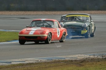 World © Octane Photographic Ltd. Donington Park 80th Anniversary Meeting (March 1933 – March 2013). HSCC Historic Road Sports Championship supported by Witchampton Garage (Inc. Class B2 Guards Trophy). Larry Kennedy's smoking Lotus Elan S4 and Peter Boyes/Jan Boyes – MGB. Digital Ref : 0594lw1d7030
