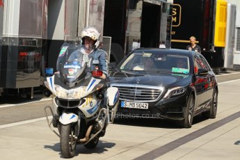 World © Octane Photographic Ltd. F1 Hungarian GP - Hungaroring, Saturday 27th July 2013 - Paddock. Bernie Ecclestone arrives with police escort. Digital Ref : 0762lw1d0715