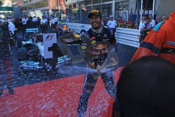 World © Octane Photographic Ltd. F1 Monaco GP, Monte Carlo - Sunday 26th May - Podium and celebrations. Infiniti Red Bull Racing's Mark Webber sprays the team and the media with champagne. Digital Ref : 0712lw1d2063