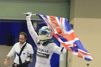 World © Octane Photographic Ltd. Sunday 23rd November 2014. Abu Dhabi Grand Prix - Yas Marina Circuit - Formula 1 Podium. Mercedes AMG Petronas – Lewis Hamilton - Race winner and 2014 World Champion. Digital Ref: 1173CB1D0435