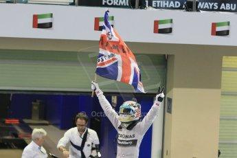 World © Octane Photographic Ltd. Sunday 23rd November 2014. Abu Dhabi Grand Prix - Yas Marina Circuit - Formula 1 Podium. Mercedes AMG Petronas – Lewis Hamilton - Race winner and 2014 World Champion. Digital Ref: 1173CB1D0439