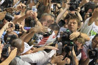 World © Octane Photographic Ltd. Sunday 23rd November 2014. Abu Dhabi Grand Prix - Yas Marina Circuit - Formula 1 Podium. Mercedes AMG Petronas – Lewis Hamilton - Race winner and 2014 World Champion greeting his team and family. Digital Ref: 1173CB1D0466