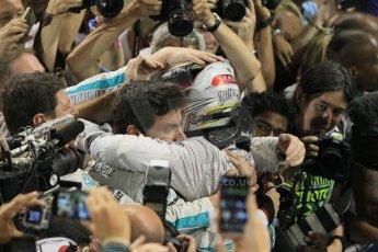 World © Octane Photographic Ltd. Sunday 23rd November 2014. Abu Dhabi Grand Prix - Yas Marina Circuit - Formula 1 Podium. Mercedes AMG Petronas – Lewis Hamilton - Race winner and 2014 World Champion greeting his team and family. Digital Ref: 1173CB1D0552