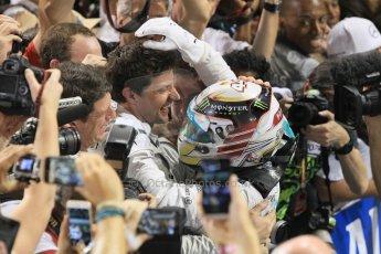World © Octane Photographic Ltd. Sunday 23rd November 2014. Abu Dhabi Grand Prix - Yas Marina Circuit - Formula 1 Podium. Mercedes AMG Petronas – Lewis Hamilton - Race winner and 2014 World Champion greeting his team and family. Digital Ref: 1173CB1D0573