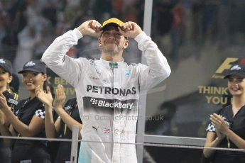 World © Octane Photographic Ltd. Sunday 23rd November 2014. Abu Dhabi Grand Prix - Yas Marina Circuit - Formula 1 Podium. Mercedes AMG Petronas – Lewis Hamilton - Race winner and 2014 World Champion. Digital Ref: 1173CB1D0733