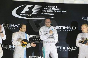 World © Octane Photographic Ltd. Sunday 23rd November 2014. Abu Dhabi Grand Prix - Yas Marina Circuit - Formula 1 Podium. Mercedes AMG Petronas – Lewis Hamilton - Race winner and 2014 World Champion. Digital Ref: 1173CB1D0854