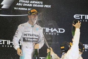 World © Octane Photographic Ltd. Sunday 23rd November 2014. Abu Dhabi Grand Prix - Yas Marina Circuit - Formula 1 Podium. Mercedes AMG Petronas – Lewis Hamilton - Race winner and 2014 World Champion. Digital Ref: 1173CB1D1162