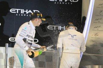 World © Octane Photographic Ltd. Sunday 23rd November 2014. Abu Dhabi Grand Prix - Yas Marina Circuit - Formula 1 Podium. Mercedes AMG Petronas – Lewis Hamilton - Race winner and 2014 World Champion. Digital Ref: 1173CB1D1182