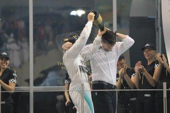 World © Octane Photographic Ltd. Sunday 23rd November 2014. Abu Dhabi Grand Prix - Yas Marina Circuit - Formula 1 Podium. Mercedes AMG Petronas – Lewis Hamilton - Race winner and 2014 World Champion and Williams Racing - Felipe Massa (2nd) and Valtteri Bottas (3rd). Digital Ref: 1173CB1D1261
