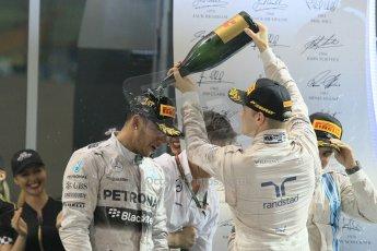 World © Octane Photographic Ltd. Sunday 23rd November 2014. Abu Dhabi Grand Prix - Yas Marina Circuit - Formula 1 Podium. Mercedes AMG Petronas – Lewis Hamilton - Race winner and 2014 World Champion and Williams Racing - Felipe Massa (2nd) and Valtteri Bottas (3rd). Digital Ref: 1173CB1D1311