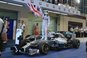 World © Octane Photographic Ltd. Sunday 23rd November 2014. Abu Dhabi Grand Prix - Yas Marina Circuit - Formula 1 Podium. Mercedes AMG Petronas – Lewis Hamilton - Race winner and 2014 World Champion. Digital Ref: 1173LB1D7622