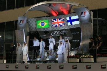 World © Octane Photographic Ltd. Sunday 23rd November 2014. Abu Dhabi Grand Prix - Yas Marina Circuit - Formula 1 Podium. Mercedes AMG Petronas – Lewis Hamilton - Race winner and 2014 World Champion and Williams Racing - Felipe Massa (2nd) and Valtteri Bottas (3rd). Digital Ref: 1173LB1DX7527
