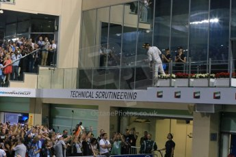 World © Octane Photographic Ltd. Sunday 23rd November 2014. Abu Dhabi Grand Prix - Yas Marina Circuit - Formula 1 Podium. Mercedes AMG Petronas – Lewis Hamilton - Race winner and 2014 World Champion. Digital Ref: 1173LB1DX7664