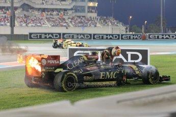 World © Octane Photographic Ltd. Sunday 23rd November 2014. Abu Dhabi Grand Prix - Yas Marina Circuit - Formula 1 Race. Lotus F1 Team E22 on fire – Pastor Maldonado. Digital Ref: