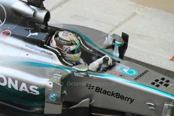 World © Octane Photographic Ltd. Sunday 23rd November 2014. Abu Dhabi Grand Prix - Yas Marina Circuit - Formula 1 Race. Mercedes AMG Petronas F1 W05 – Lewis Hamilton on his out lap from the pits. Digital Ref: