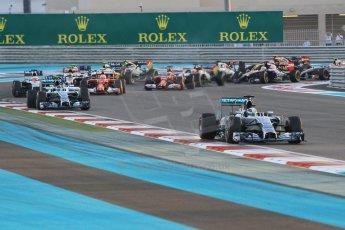 World © Octane Photographic Ltd. Sunday 23rd November 2014. Abu Dhabi Grand Prix - Yas Marina Circuit - Formula 1 Race. Mercedes AMG Petronas F1 W05 – Lewis Hamilton and Nico Rosberg lead the pack on the opening lap. Digital Ref: