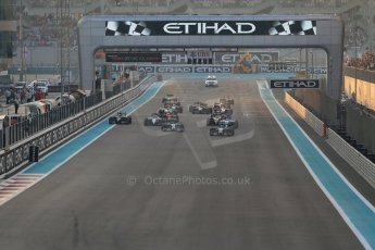 World © Octane Photographic Ltd. Sunday 23rd November 2014. Abu Dhabi Grand Prix - Yas Marina Circuit - Formula 1 Race. Mercedes AMG Petronas F1 W05 – Lewis Hamilton pulls away as Nico Rosberg gets a poor start and fights with the pack on the opening lap. Digital Ref: