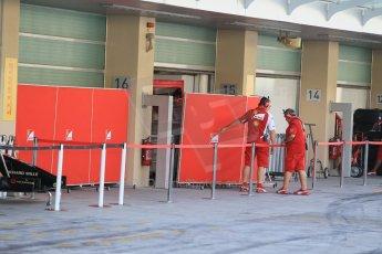 World © Octane Photographic Ltd. Tuesday 25th November 2014. Abu Dhabi Testing - Yas Marina Circuit. Scuderia Ferrari garage with barriers. Digital Ref: 1174CB1D8193