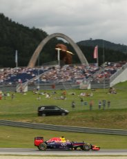 World © Octane Photographic Ltd. Saturday 21st June 2014. Red Bull Ring, Spielberg - Austria - Formula 1 Practice 3. Infiniti Red Bull Racing RB10 - Sebastian Vettel and media shuttle bus. Digital Ref: 0995LB1D1402