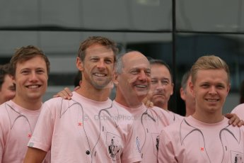 World © Octane Photographic Ltd. Saturday 5th July 2014. British GP, Silverstone, UK. - Formula 1 Paddock. Jenson Button, Kevin Magnussen, Ron Dennis and the McLaren team in their #Pinkforpapa shirts. Digital Ref: 1025LB1D0634