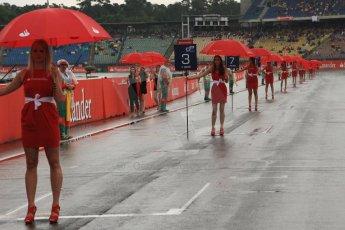 World © Octane Photographic Ltd. Sunday 20th July 2014. GP2 Race 2 – German GP - Hockenheim. The grid girls with umbrellas on the start grid. Digital Ref : 1050CB7D6561