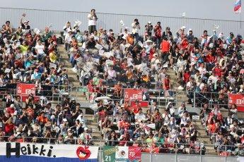 World © Octane Photographic Ltd. Friday 3rd October 2014, Japanese Grand Prix - Suzuka. - Formula 1 Practice 2. Heikki Kovalainen fans flags. Digital Ref: