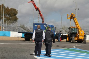 World © Octane Photographic Ltd. 2014 Formula 1 Winter Testing, Circuito de Velocidad, Jerez. Tuesday 28th January 2014. Day 1. Mercedes AMG Petronas F1 W05 – Lewis Hamilton. FIA members walk up the track to view the damage which Lewis Hamilton caused after crashing into barriers at turn one. Digital Ref: 0882lw7d7430