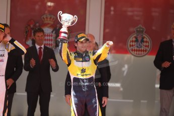 World © Octane Photographic Ltd. Friday 23rd May 2014. GP2 Feature Race – Monaco, Monte Carlo. Felipe Nasr raises hos 3rd place trophy - Carlin. Digital Ref : 0963CB7D3137