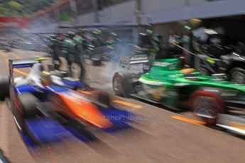 World © Octane Photographic Ltd. Friday 23rd May 2014. GP2 Feature Race – Monaco, Monte Carlo. Rio Haryanto - EQ8 Caterham Racing and Johnny Cecotto - Trident come close on the pit release. Digital Ref : 0963CB7D5332