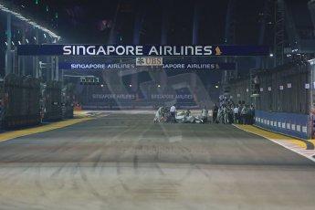 World © Octane Photographic Ltd. Sunday 21st September 2014, Singapore Grand Prix, Marina Bay. - Formula 1 Race formation lap gets underway as Nico Rosberg's Mercedes AMG Petronas F1 W05 is wheeled off the grid. Digital Ref: 1127LB1D3189