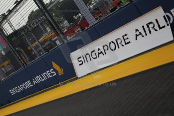 World © Octane Photographic Ltd. Wednesday 17th September 2014, Singapore Grand Prix, Marina Bay. Formula 1 Setup and atmosphere. New Singapore Airlines sponsorship being applied. Digital Ref: 1115CB1D6496