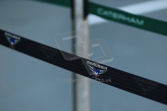 World © Octane Photographic Ltd. Wednesday 17th September 2014, Singapore Grand Prix, Marina Bay. Formula 1 Setup and atmosphere. Caterham F1 Team and Marussia F1 team pit barriers. Digital Ref: 1115LB1D8724