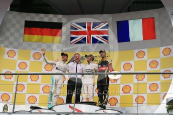 World © Octane Photographic Ltd. Mercedes AMG Petronas F1 W06 Hybrid – Lewis Hamilton (1st), Nico Rosberg (2nd) and Lotus F1 Team E23 Hybrid – Romain Grosjean (3rd). Sunday 23rd August 2015, F1 Belgian GP Podium, Spa-Francorchamps, Belgium. Digital Ref: 1390LB1D2511