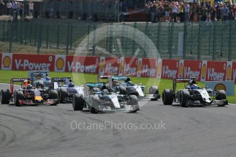 World © Octane Photographic Ltd. Mercedes AMG Petronas F1 W06 Hybrid – Lewis Hamilton and Sahara Force India VJM08B – Sergio Perez side by side into La Source hairpin on lap 1. Sunday 23rd August 2015, F1 Belgian GP Race, Spa-Francorchamps, Belgium. Digital Ref: 1389LB1D2030